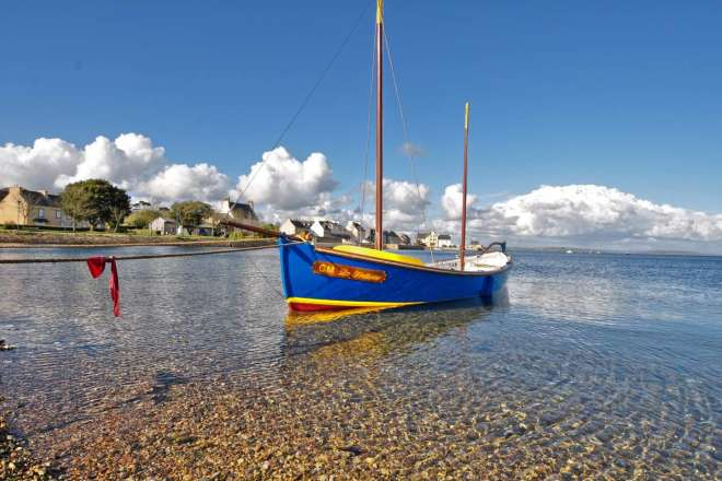 old breton sailboat in the background Le Fret -